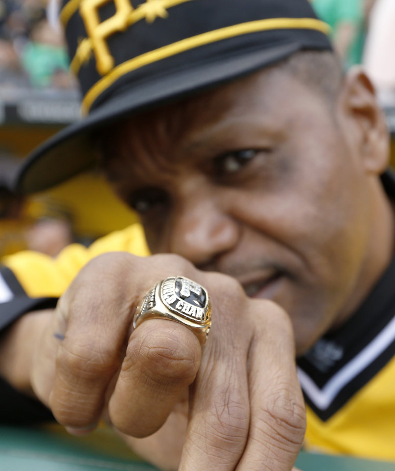 Photo - Former Pittsburgh Pirates center fielder Omar Moreno shows off the World Series ring he won with the 1979 Pirates against the Baltimore Orioles before the baseball game between the Pittsburgh Pirates and the Baltimore Orioles on Wednesday, May 21, 2014, in Pittsburgh.  The Pirates pre-game  festivities honored the last Pirates team to win a World Series. (AP Photo/Keith Srakocic)