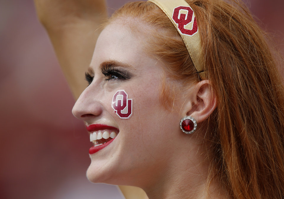 A member of the Oklahoma cheer squad performs during the Red River Rivalry college football game between the University of Oklahoma Sooners (OU) and the University of Texas Longhorns (UT) at the Cotton Bowl Stadium in Dallas, Saturday, Oct. 12, 2013. Photo by Chris Landsberger, The Oklahoman