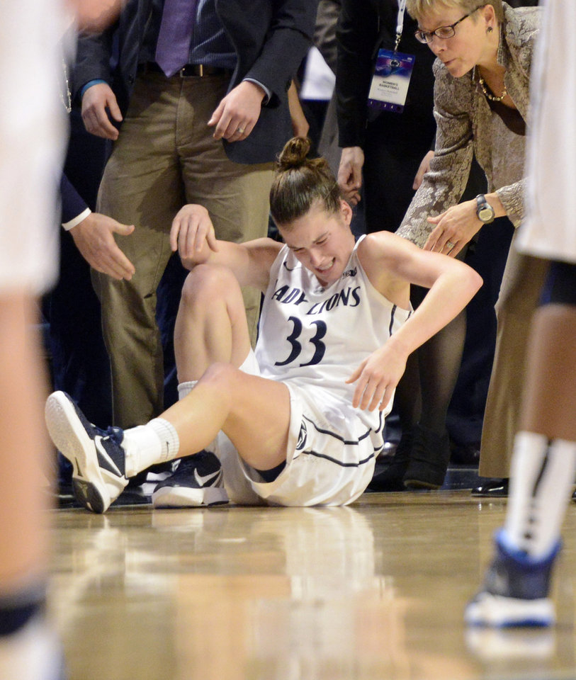 Photo - Penn State's Maggie Lucas (33) is helped to her feet in the second half of an NCAA college basketball game against Connecticut, Sunday, Nov. 17, 2013, in State College, Pa. Lucas returned to the game. Connecticut won 71-52. (AP Photo/John Beale)