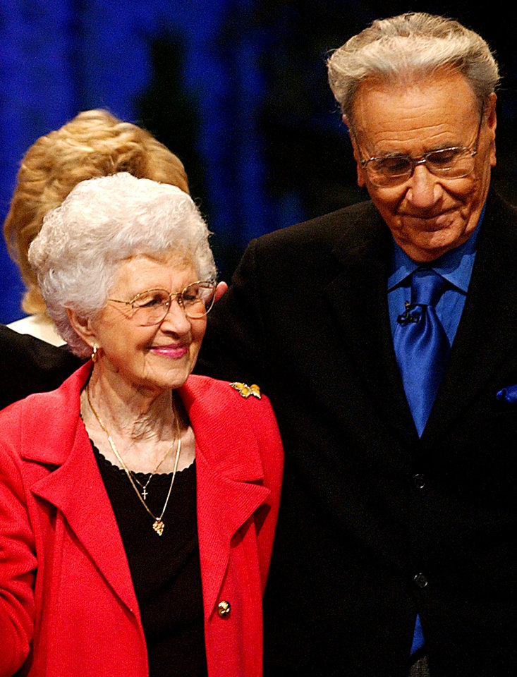 Photo - Oral Roberts, right, and his wife, Evelyn Roberts, makes an appearance at a conference, June 15, 2004, at the Mabee Center on the campus of Oral Roberts University in Tulsa, Okla. Evelyn died Wednesday, May 4, 2005, in a California hospital after suffering a head injury during a fall. She was 88. (AP Photo/Tulsa World, Kelly Kerr)
