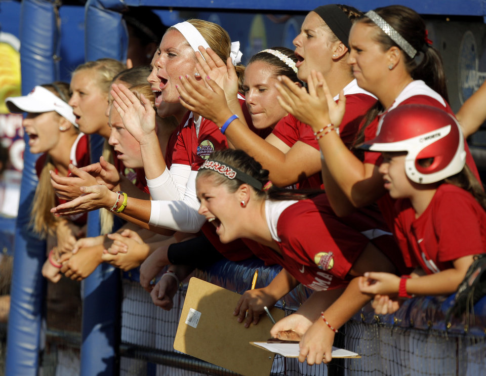 The Oklahoma team cheers during a Women's College World Series game at ASA Hall of Fame Stadium in Oklahoma City, Friday, June 1, 2012.  Photo by Bryan Terry, The Oklahoman