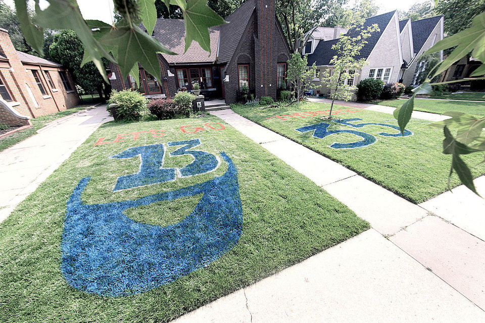Photo - Above:  A house at 220 NW 34 Street in Oklahoma City is decorated with Thunder pride on Monday. Photo by Garett Fisbeck, The Oklahoman