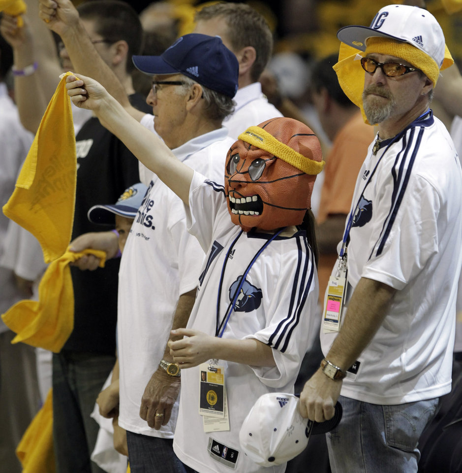 Photo - Memphis Grizzlies fans cheer during the first half of Game 3 against the Oklahoma City Thunder in a second-round NBA basketball series on Saturday, May 7, 2011, in Memphis, Tenn. (AP Photo/Lance Murphey)