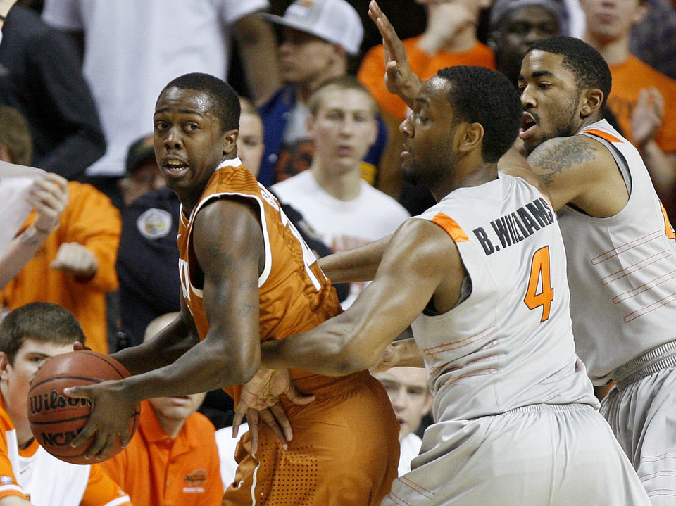 Photo - Texas' J'Covan Brown (14) looks to pass beside Oklahoma State's Brian Williams (4) and Michael Cobbins (20) during an NCAA college basketball game between Oklahoma State University (OSU) and the University of Texas (UT) at Gallagher-Iba Arena in Stillwater, Okla., Saturday, Feb. 18, 2012. Oklahoma State won 90-78. Photo by Bryan Terry, The Oklahoman