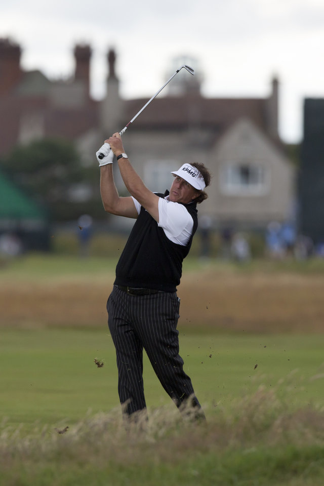 Photo - Phil Mickelson of the US plays a shot on the 2nd during a practice round at Royal Liverpool Golf Club prior to the start of the British Open Golf Championship, in Hoylake, England, Monday, July 14, 2014. The 2014 Open Championship starts on Thursday, July 17. (AP Photo/Jon Super)