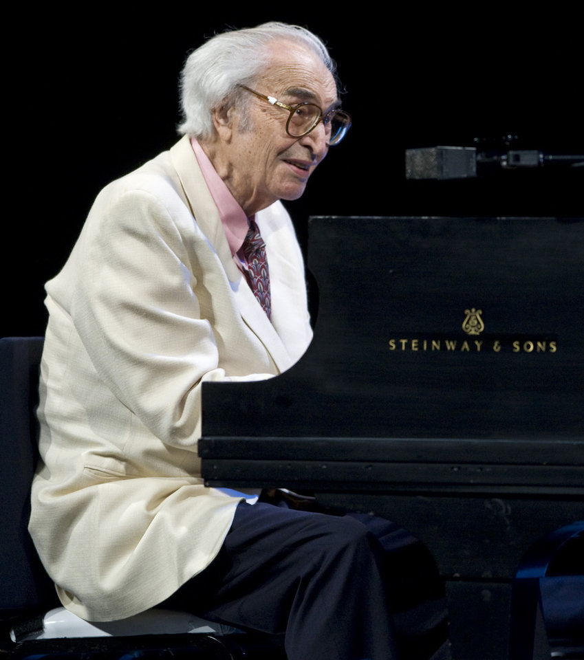 "FILE - This July 4, 2009 file photo shows Jazz legend Dave Brubeck performing at the 30th edition of the Montreal International Jazz Festival  in Montreal.  Brubeck's ""Take Five"" was the most viral tracks on Spotify for the week of Dec. 3, 2012. Brubeck, a pioneering jazz composer and pianist died Dec. 5, of heart failure. (AP Photo/The Canadian Press, Paul Chiasson)"