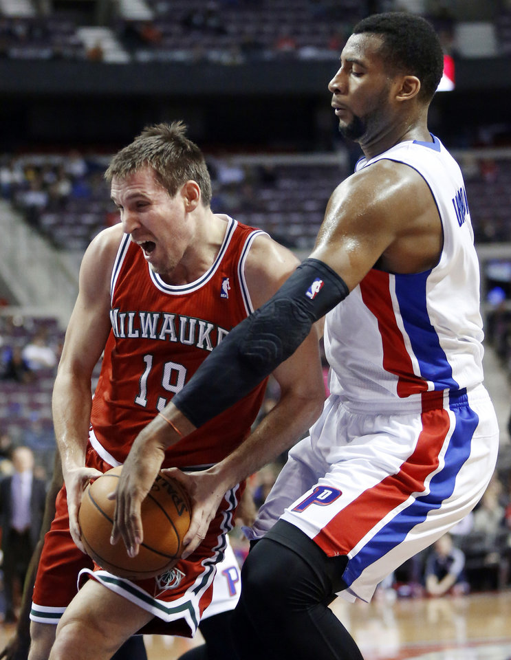 Photo - Milwaukee Bucks guard Beno Udrih (19) goes to the basket as Detroit Pistons forward Andre Drummond, right, tries to knock the ball away in the first half of an NBA basketball game Tuesday, Jan. 29, 2013, in Detroit. (AP Photo/Duane Burleson)