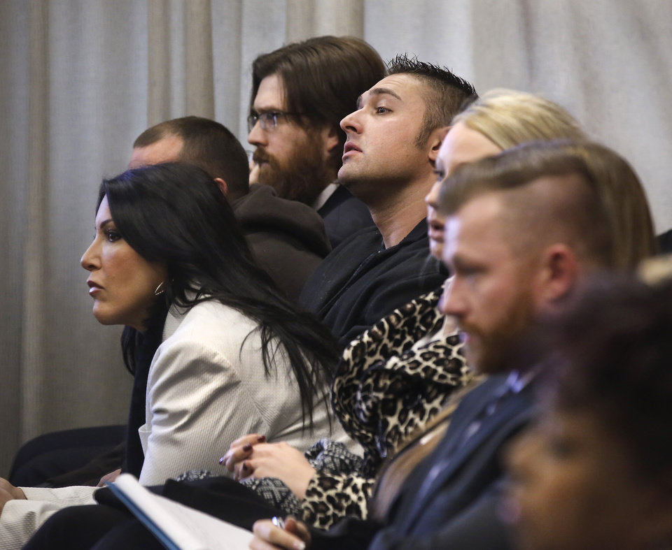 Photo -  Spectators fill the small courtroom to watch and hear testimony during a preliminary hearing for Daniel Holtzclaw, an Oklahoma City police officer accused of 34 crimes, including several counts of first-degree rape. Photo by Jim Beckel, The Oklahoman   Jim Beckel -
