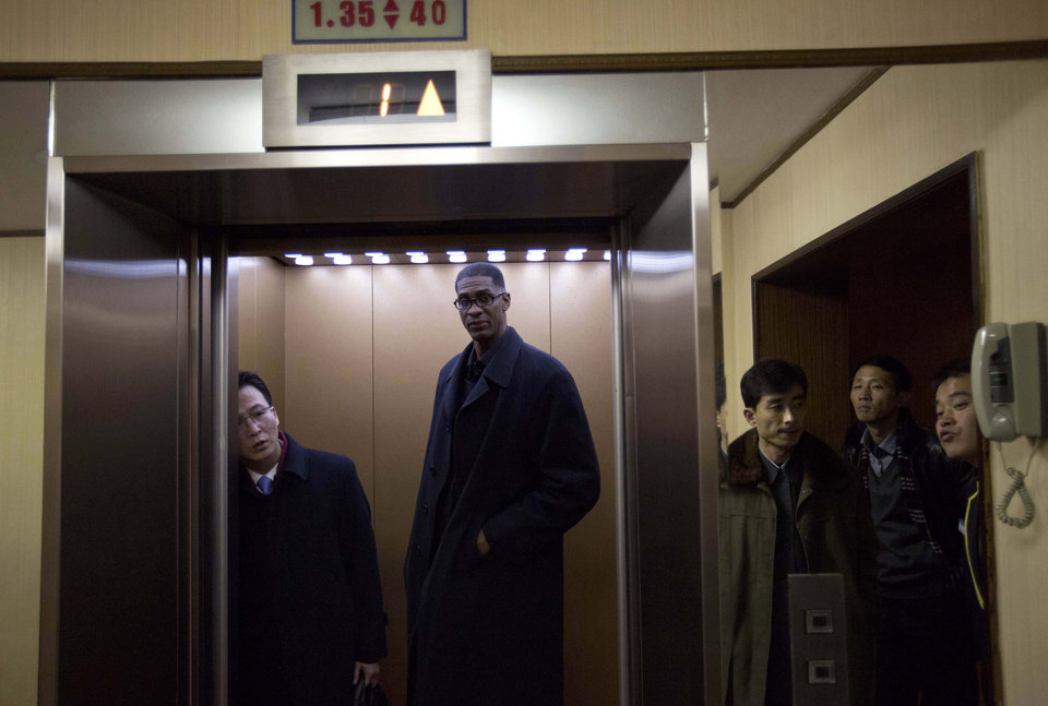 Photo - Former NBA basketball star Charles D. Smith enters an elevator at a hotel in Pyongyang, North Korea on Monday, Jan. 6, 2014. Dennis Rodman arrived in North Korea on Monday with a team of fellow former NBA players, including Smith, for an exhibition game on leader Kim Jong Un's birthday, after saying he wants to show that North Korea isn't so bad. (AP Photo/David Guttenfelder)