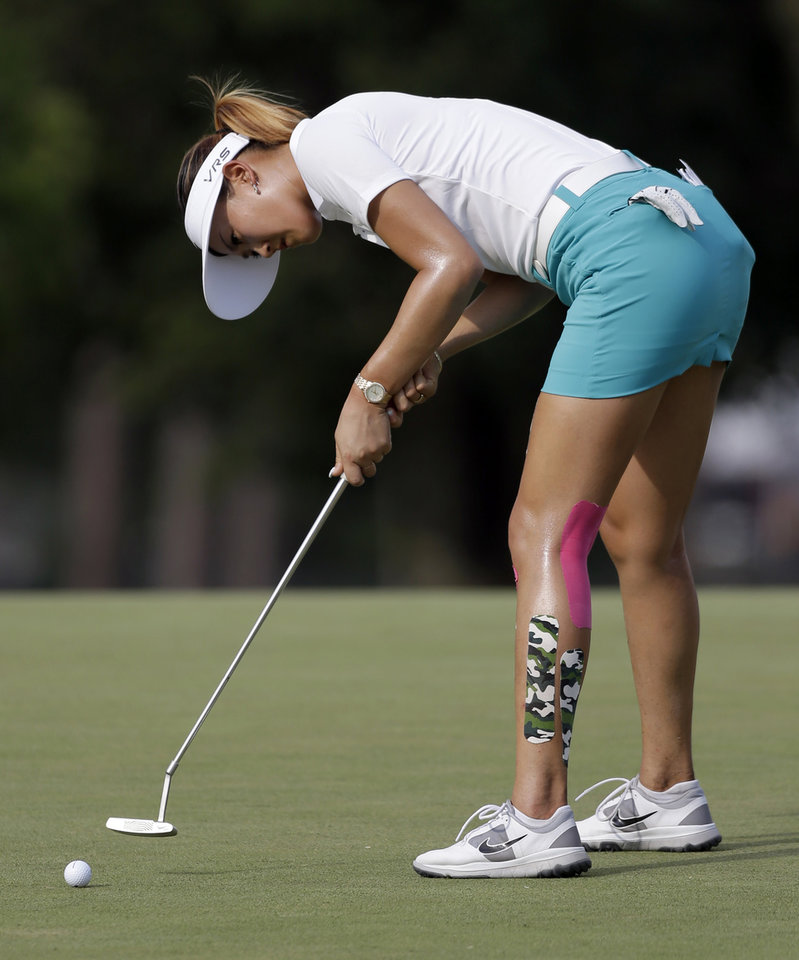 Photo - Michelle Wie putts on the 14th hole during the first round of the LPGA U.S. Women's Open golf tournament in Pinehurst, N.C., Thursday, June 19, 2014. (AP Photo/Bob Leverone)