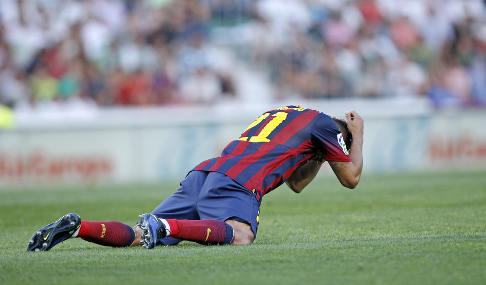 Photo - Barcelona's Adriano Correia from Brazil reacts after failing to score against Elche during a Spanish La Liga soccer match at the Martinez Valero stadium in Elche, Spain, on Sunday, May 11, 2014. (AP Photo/Alberto Saiz)