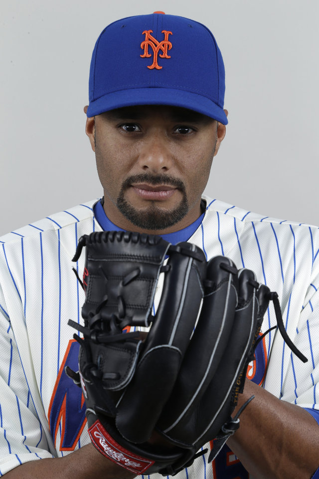 Photo - FILE - In this 2013 file photo, New York Mets pitcher Johan Santana poses at spring training camp in Port St. Lucie, Fla. The two-time AL Cy Young Award winner has agreed to a minor league contract with the Baltimore Orioles, in a deal announced Tuesday, March 4, 2014,  as he tries to come back from the second major operation on his left shoulder.  (AP Photo/Julio Cortez, File)