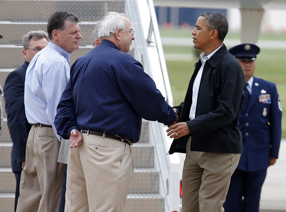 Photo - President Barack Obama greets Tom Cole and Adminstrator of FEMA, W. Craig Fugate at Tinker Air Force base in Midwest City, Sunday, May 26, 2013. Obama was in town to visit areas damaged by the May 20 tornado. Photo by Sarah Phipps, The Oklahoman