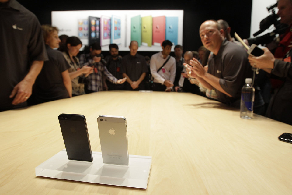 The new Apple iPhone 5 is displayed  Sept. 12 following the introduction of new products in San Francisco.  The iPhone 5 is a blend of beauty, utility and versatility. AP Photo <strong>Eric Risberg</strong>