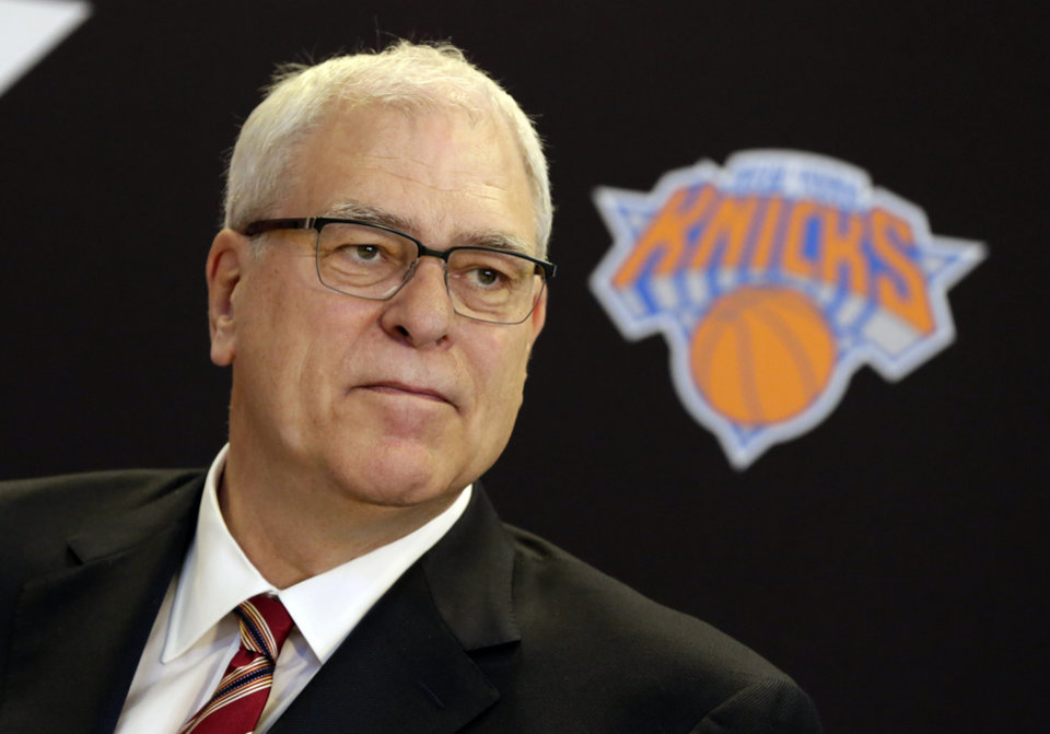 Photo - New York Knicks new team president Phil Jackson listens to a question during a news conference where he was introduced, at New York's Madison Square Garden, Tuesday, March 18, 2014. Jackson signed a five-year contract that will reportedly pay him at least $12 million annually and said he will spend significant time in New York.(AP Photo/Richard Drew)