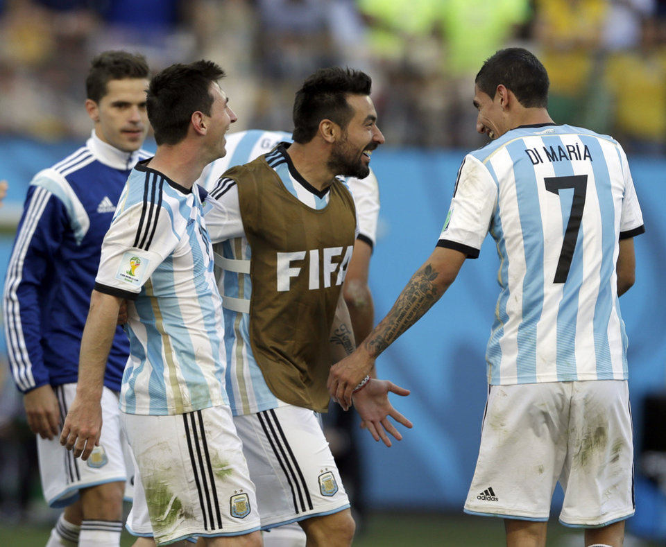Photo - Argentina's Fernando Gago, left, Lionel Messi, Ezequiel Lavezzi and Angel di Maria celebrate after the World Cup round of 16 soccer match between Argentina and Switzerland at the Itaquerao Stadium in Sao Paulo, Brazil, Tuesday, July 1, 2014.  Argentina beat Switzerland 1-0 after extra time. (AP Photo/Ricardo Mazalan)