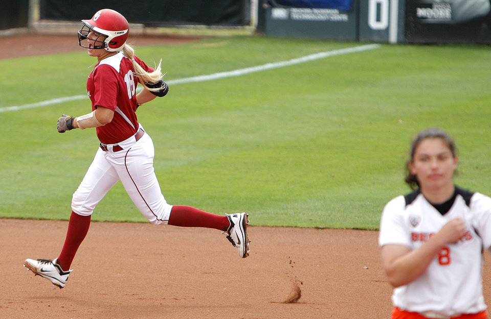 Photo - Oklahoma's Jessica Shults celebrates a grand slam home run in front of Oregon State pitcher Marina Demore an NCAA softball regional between the University of Oklahoma and  Oregon State in Norman, Okla., Sunday, May 20, 2012. Photo by Sarah Phipps, The Oklahoman