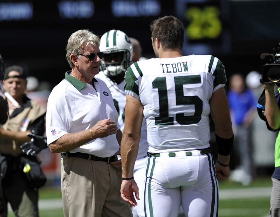 "FILE - In a Sunday, Sept. 9, 2012, file photo, New York Jets special teams coach Mike Westhoff speaks with quarterback Tim Tebow before an NFL football game against the Buffalo Bills at MetLife Stadium in East Rutherford, N.J. Tebow barely played during a massively disappointing one-year experiment, which recently retired special teams coordinator Mike Westhoff labeled ""an absolute mess.""  (AP Photo/Bill Kostroun, File)"