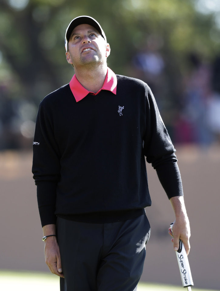 First round co-leader Matt Bettencourt, of Spartanburg, S.C., reacts to missing a birdie putt on the 18th green during the second round of the Texas Open golf tournament, Friday, April 5, 2013, in San Antonio. (AP Photo/Eric Gay)