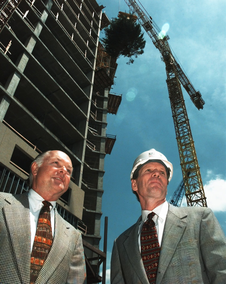Photo - April 30, 1999: Former Mayor Ron Norick and Flintco Vice-President Jay Harris watch as a symbolic tree is hoisted to the top of the Marriott Renaissance Hotel in a topping off ceremony in downtown Oklahoma City. [Photo by Steve Sisney, The Oklahoman Archives]