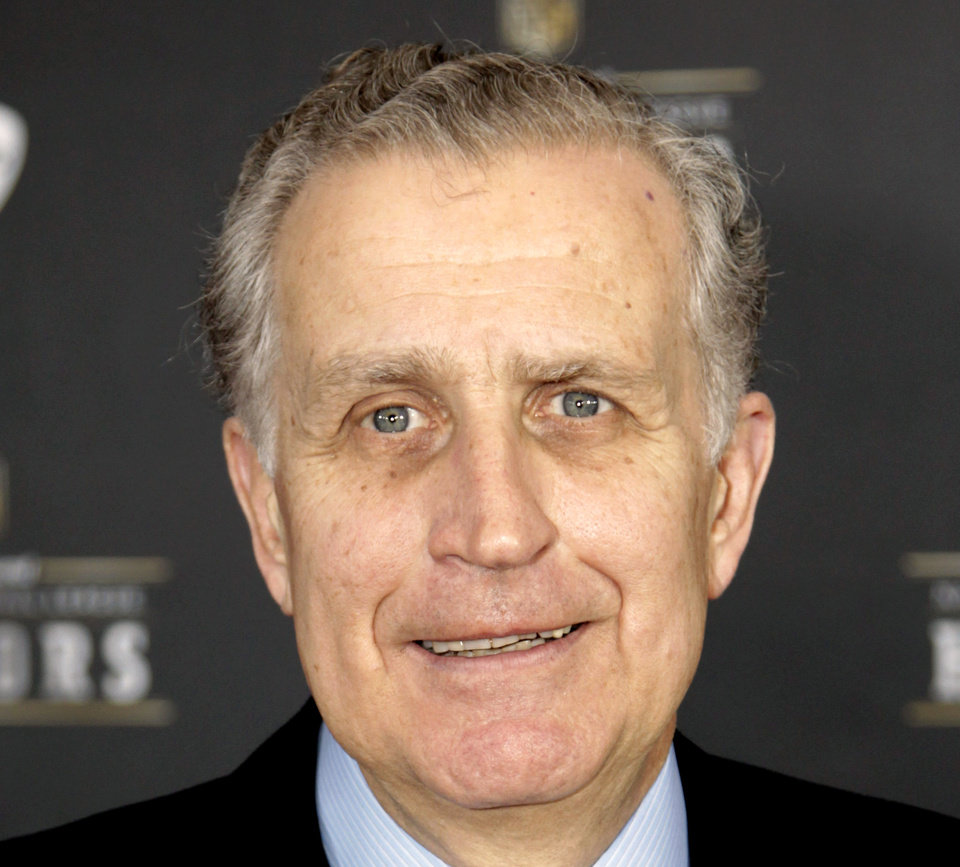 FILE - This Feb. 4, 2012 file photo shows former NFL Commissioner Paul Tagliabue in Indianapolis. Tagliabue and lawyers for the league and the players' union have arrived on Capitol Hill in Washington, Thursday for a hearing in the Saints bounties case. Tagliabue is overseeing the latest round of player appeals in Washington.  (AP Photo/David Stluka, File)