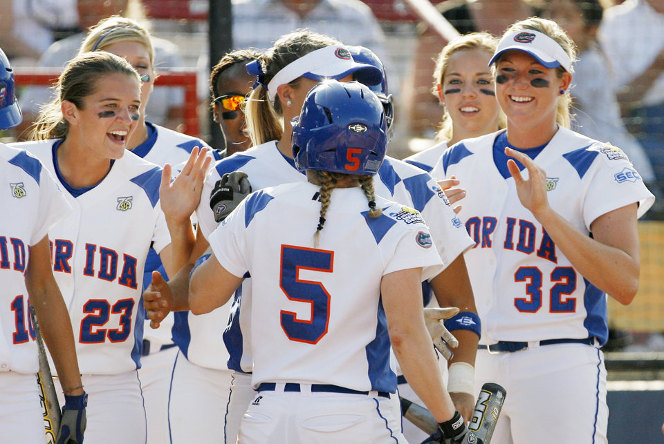Florida celebrates a run by Kim Waleszonia (5) in the first inning during the softball game in the Women's College World Series between UCLA and Florida at ASA Hall of Fame Stadium in Oklahoma City, Saturday, May 31, 2008. Florida won, 2-0. BY NATE BILLINGS, THE OKLAHOMAN