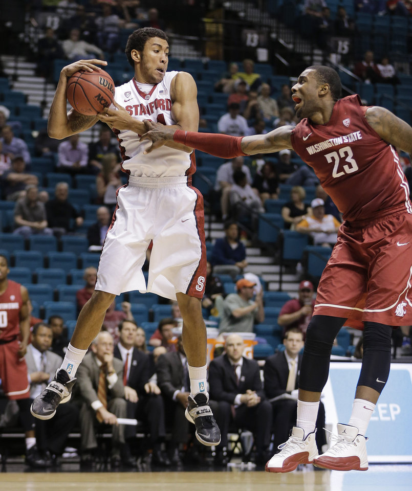 Photo - Stanford's Josh Huestis grabs a rebound from Washington State's D.J. Shelton in the first half of an NCAA Pac-12 conference tournament college basketball game, Wednesday, March 12, 2014, in Las Vegas. (AP Photo/Julie Jacobson)