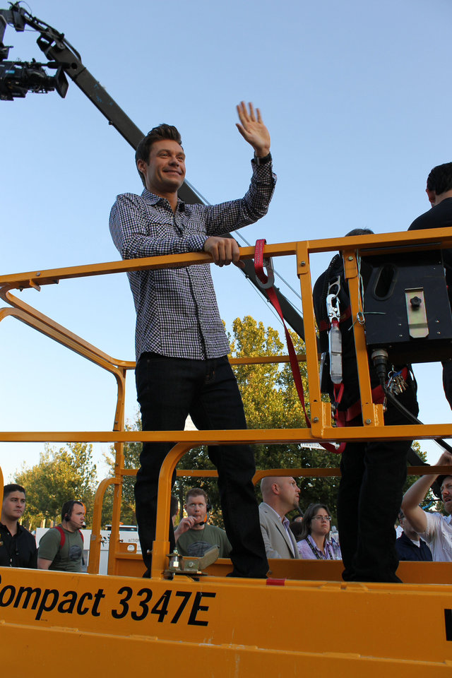 "Ryan Seacrest stands in the basket of a cherry picker as he shoots scenes for season 12 of ""American Idol"" at the show's Oklahoma City auditions on Friday, July 20. Photo by Heather Warlick, The Oklahoman. <strong></strong>"