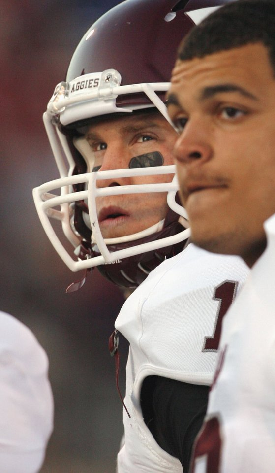 Texas A&M's Ryan Tannehill (17) watches the clock during the second half of the college football game where the Texas A&M Aggies were defeated by the University of Oklahoma Sooners (OU) 41-25 at Gaylord Family-Oklahoma Memorial Stadium on Saturday, Nov. 5, 2011, in Norman, Okla. Photo by Steve Sisney, The Oklahoman