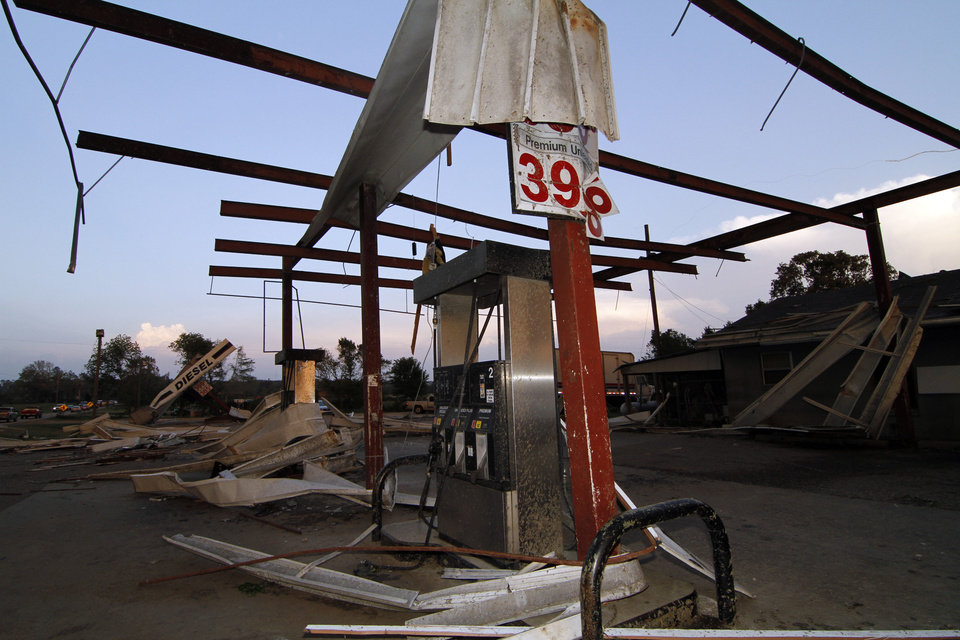 Photo - A steel frame is all that remains of the fuel stand at Cheatham's Grocery Store in Coy, Miss., following a tornado touchdown Wednesday, April 27, 2011. Several tornadoes hit  in the state resulting in number of deaths. (AP Photo/Rogelio V. Solis)