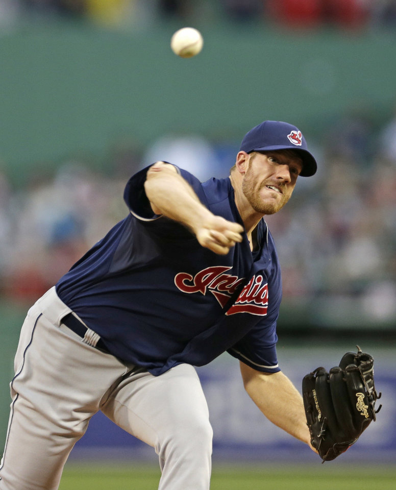 Photo - Cleveland Indians starting pitcher Zach McAllister delivers to the Boston Red Sox during the first inning of a baseball game at Fenway Park in Boston, Thursday, May 23, 2013. (AP Photo/Charles Krupa)