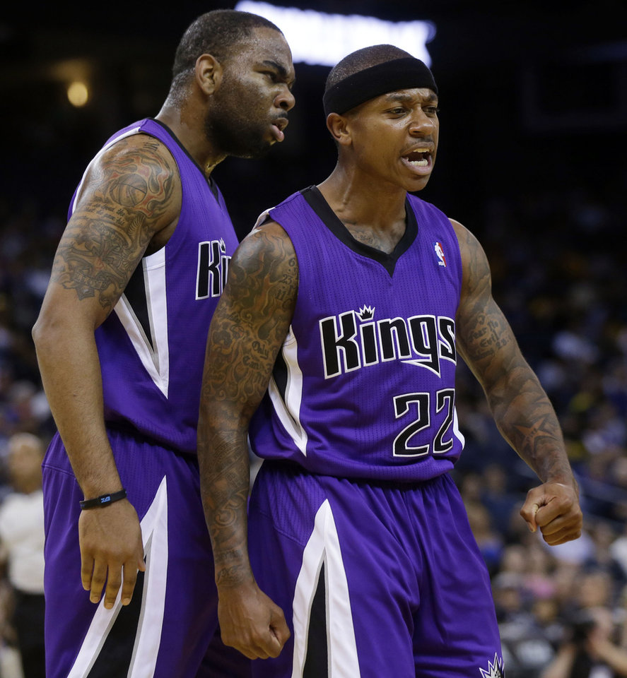 Photo - Sacramento Kings' Isaiah Thomas (22) celebrates after scoring, with teammate Marcus Thornton during the first half of an NBA preseason basketball game against the Golden State Warriors on Monday, Oct. 7, 2013, in Oakland, Calif. (AP Photo/Marcio Jose Sanchez)