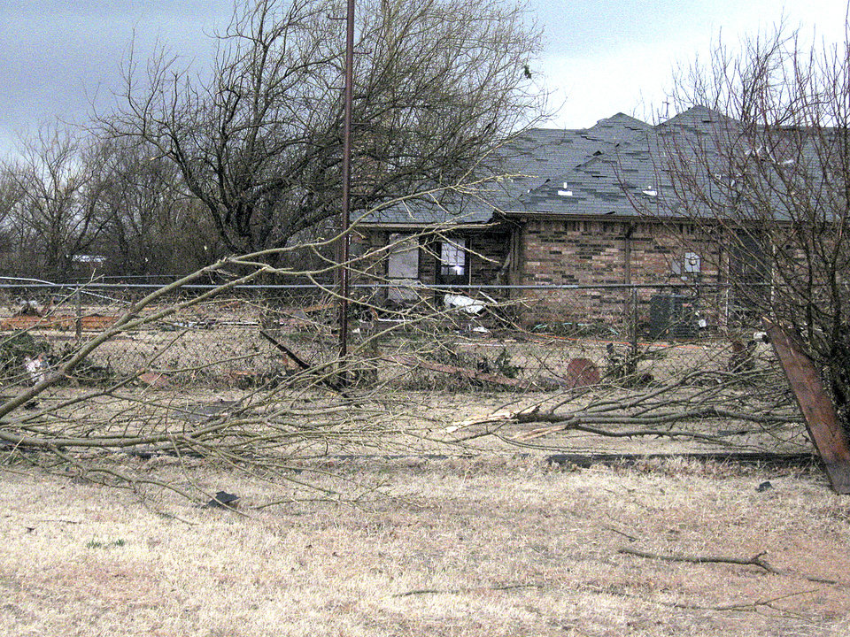 Several trees were toppled in the Big Cedar addition. PHOTO BY JOHN A. WILLIAMS, THE OKLAHOMAN