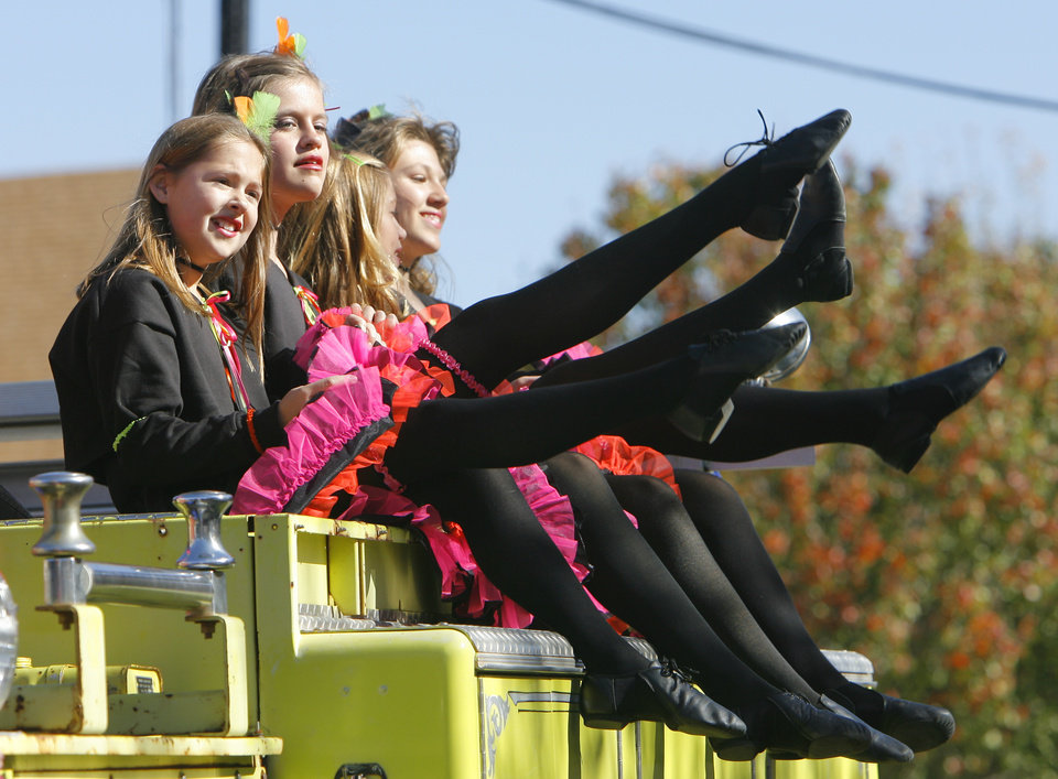Photo - A group of girls do the Can-Can on top a fire truck in the Centennial Parade in Guthrie, Friday, November 16, 2007.  By David McDaniel, The Oklahoman
