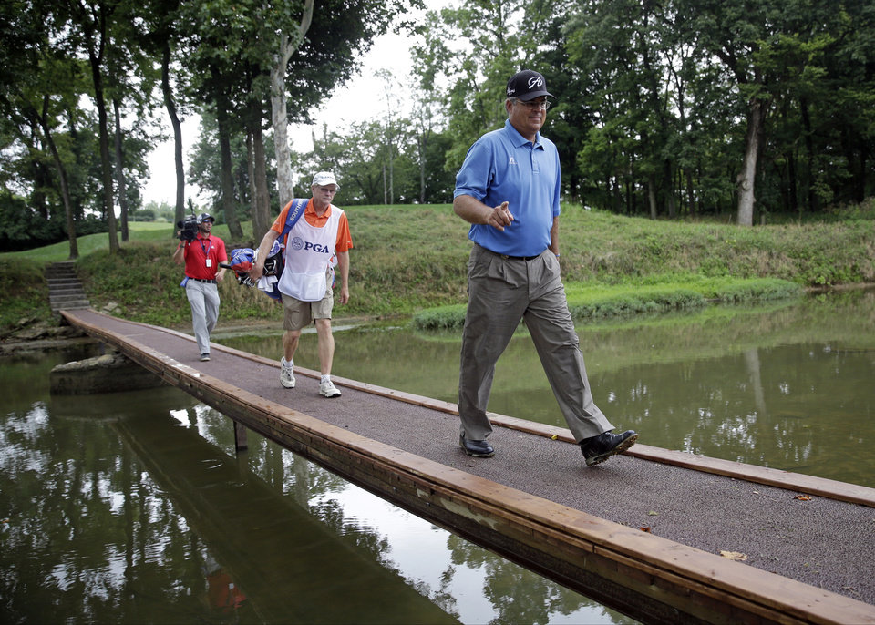 Photo - Kenny Perry walks across the bridge on the ninth hole during the third round of the PGA Championship golf tournament at Valhalla Golf Club on Saturday, Aug. 9, 2014, in Louisville, Ky. (AP Photo/David J. Phillip)