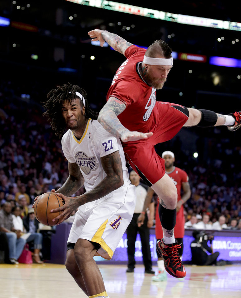 Photo - Miami Heat forward Chris Andersen, right, fouls Los Angeles Lakers center Jordan Hill during the first half of an NBA basketball game in Los Angeles, Wednesday, Dec. 25, 2013. (AP Photo/Chris Carlson)