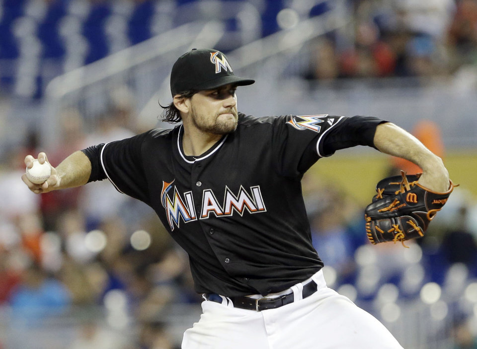 Photo - Miami Marlins' Nathan Eovaldi delivers a pitch during the first inning of a baseball game against the Oakland Athletics, Saturday, June 28, 2014, in Miami. (AP Photo/Wilfredo Lee)