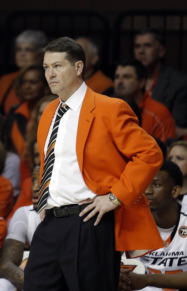 Photo - Oklahoma State men's basketball coach Travis Ford reacts during the men's Bedlam college game between Oklahoma and Oklahoma State at Gallagher-Iba Arena in Stillwater, Okla., Saturday, Feb. 15, 2014. Photo by Sarah Phipps, The Oklahoman