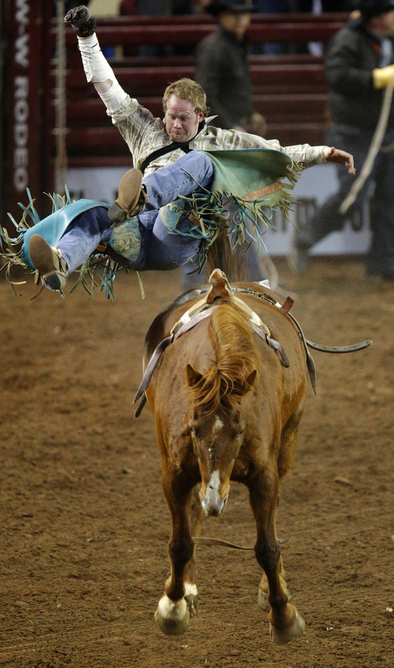 Matt Ford of Grant, Mich., flies off during the bareback bronc competition in the International Finals Rodeo inside the State Fair Arena in Oklahoma City, Friday, Jan. 18, 2013. Photo by Bryan Terry, The Oklahoman
