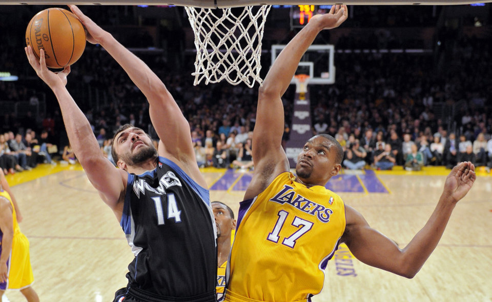 Minnesota Timberwolves center Nikola Pekovic, left, of Montenegro, puts up a shot as Los Angeles Lakers center Andrew Bynum defends during the first half of an NBA basketball game, Wednesday, Feb. 29, 2012, in Los Angeles. (AP Photo/Mark J. Terrill)