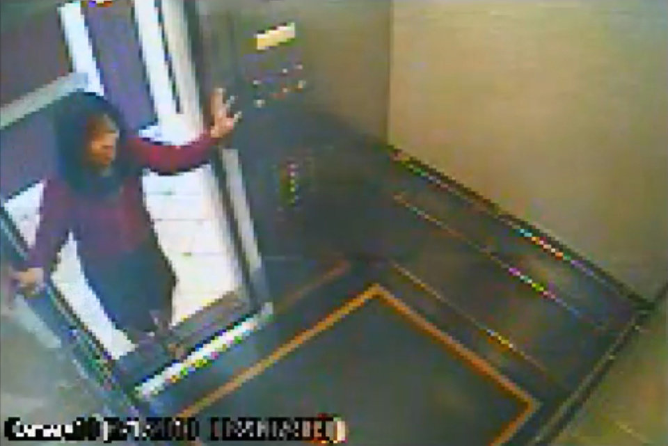 This still image taken from a security video was released on Feb. 13, 2013, by the Los Angeles Police Department in connection with the search for 21-year-old missing Canadian tourist Elisa Lam. In this image, a woman believed to be Lam enters an elevator in the Cecil Hotel in downtown Los Angeles on Thursday, Jan. 31, the last day she was seen alive. A maintenance worker at the hotel found Lam's body in a water cistern on the building's roof on Feb. 19, more than two weeks after she had gone missing. (AP Photo/Los Angeles Police Department)