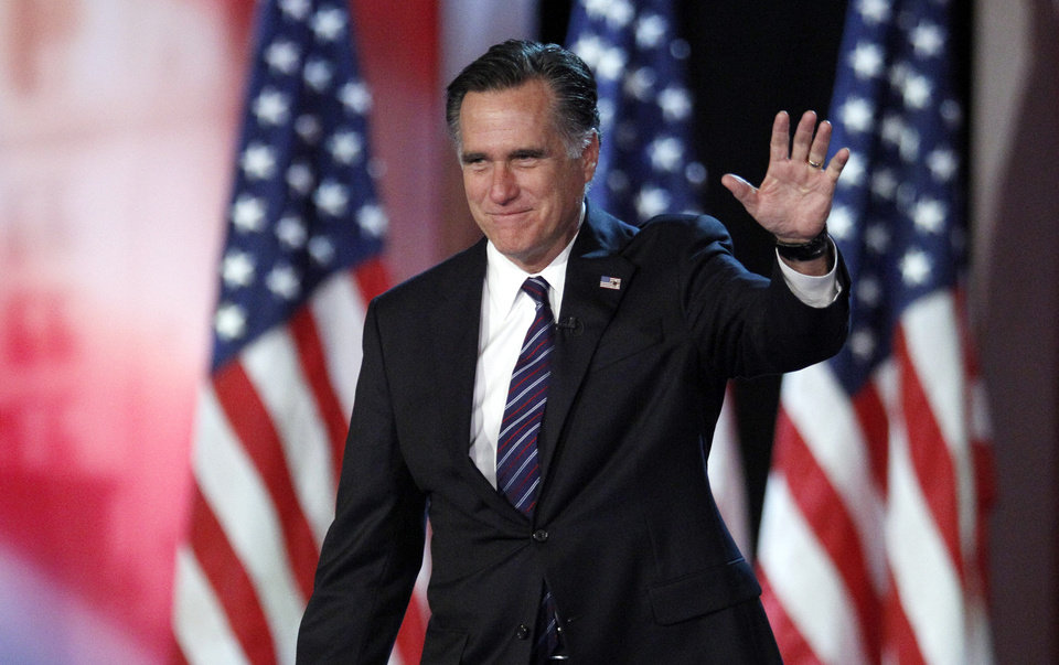 FILE - In this Nov. 7, 2012, file photo, Republican presidential candidate and former Massachusetts Gov. Mitt Romney waves to supporters at an election night rally in Boston, where he conceded the race to President Barack Obama. Romney has emerged from nearly four months in seclusion for an interview with Fox News. He's also scheduled to deliver his first postelection speech this month at Washington's Conservative Political Action Conference. (AP Photo/Stephan Savoia, File)