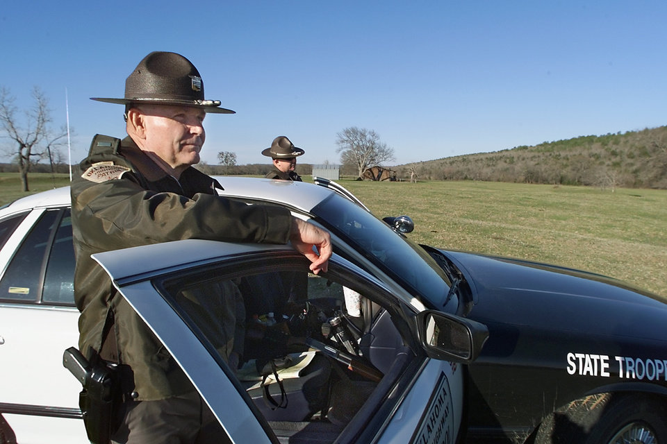 ESCAPE, ESCAPEE, PRISON ESCAPEES: Oklahoma State Troopers second Lt. Byron Lamb & Trooper Steve Payne look for two Stringtown - Mack Alford Correctional Center escapees 2 &1/2 miles south of Stringtown, The escapees ditched their stolen car in the hills near Boggy creek .  Staff Photo By Steve Gooch /  KWTV NEWS9
