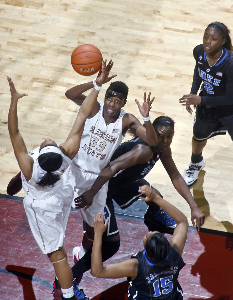 Photo - Florida State forward Natasha Howard (33) eyes a rebound as Duke center/forward Elizabeth Williams (1) tries to box her out in the first half of an NCAA college basketball game, Thursday, Jan. 23, 2014, in Tallahassee, Fla. (AP Photo/Phil Sears)
