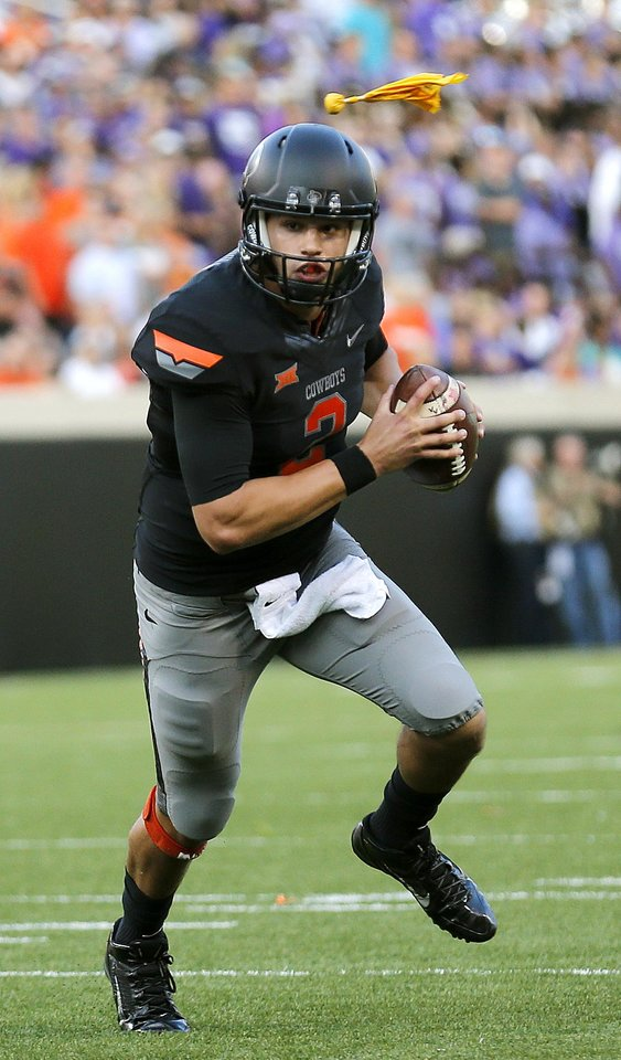 Photo - Oklahoma State's Mason Rudolph (2) rushes during the college football game between the Oklahoma State Cowboys (OSU) and the Central Arkansas Bears at Boone Pickens Stadium in Stillwater, Okla., Saturday, Sept. 12, 2015. Photo by Sarah Phipps, The Oklahoman