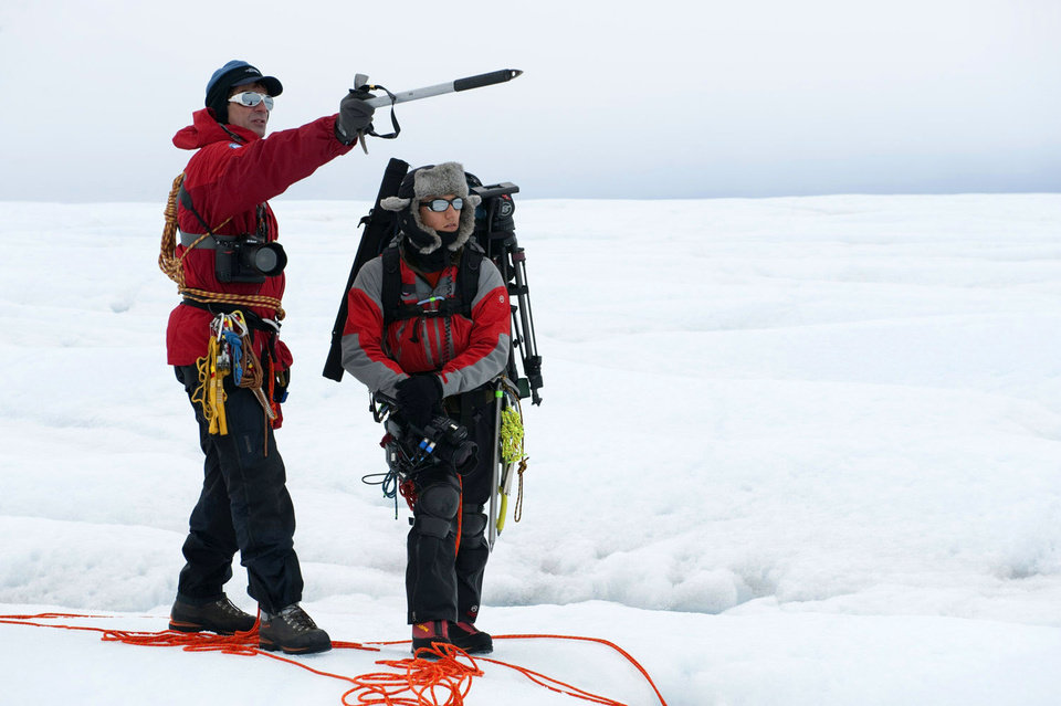 Photo -   This 2009 image released by Extreme Ice Survey shows photographer James Balog, left, and director Jeff Orlowski as the scout Survey Canyon in Greenland. The film, about climate change, follows Balog across the Arctic as he deploys revolutionary time-lapse cameras designed to capture a multi-year record of the world's changing glaciers. (AP Photo/Extreme Ice Survey, Adam LeWinter)