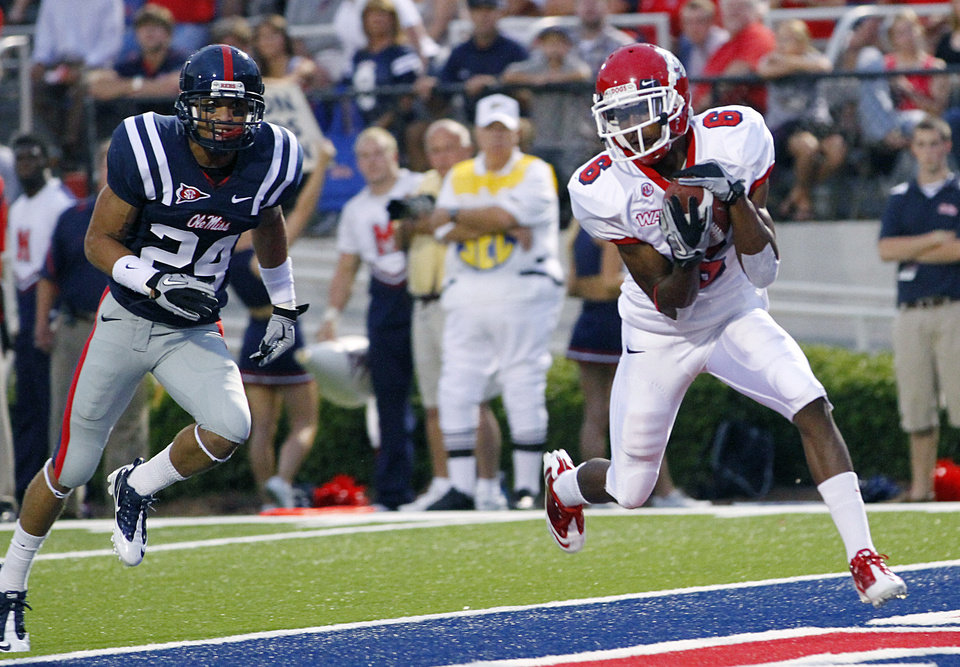 Fresno State\'s Jalen Saunders (6) pulls in a first-quarter touchdown pass in front of Mississippi defensive back Tony Grimes (24) during their NCAA college football game in Oxford, Miss., Saturday, Sept. 25, 2010. (AP Photo/Rogelio V. Solis)