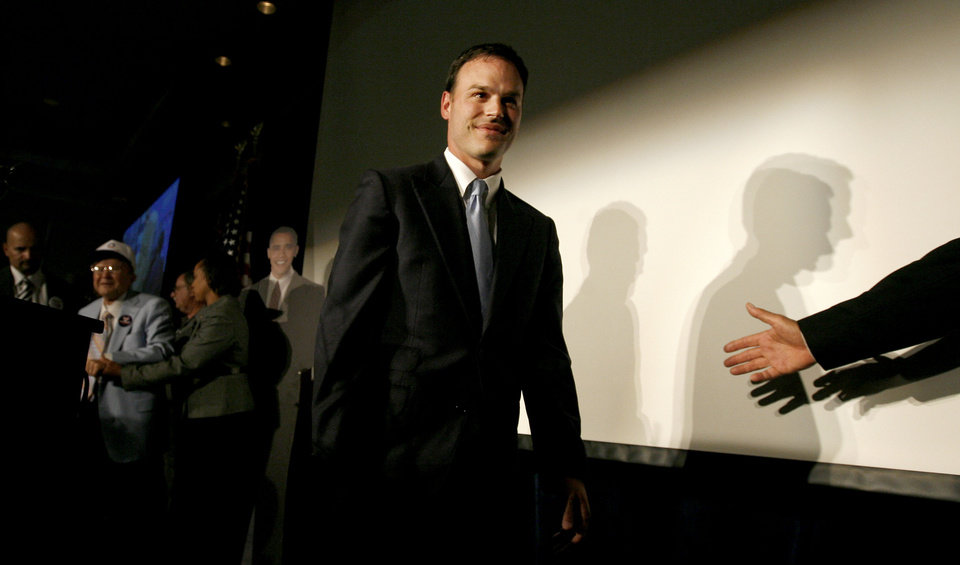 Photo - Andrew Rice walks off stage after speaking to the crowd during the Democratic watch party for the presidential election in Oklahoma City, Tuesday, November 4, 2008. BY BRYAN TERRY, THE OKLAHOMAN