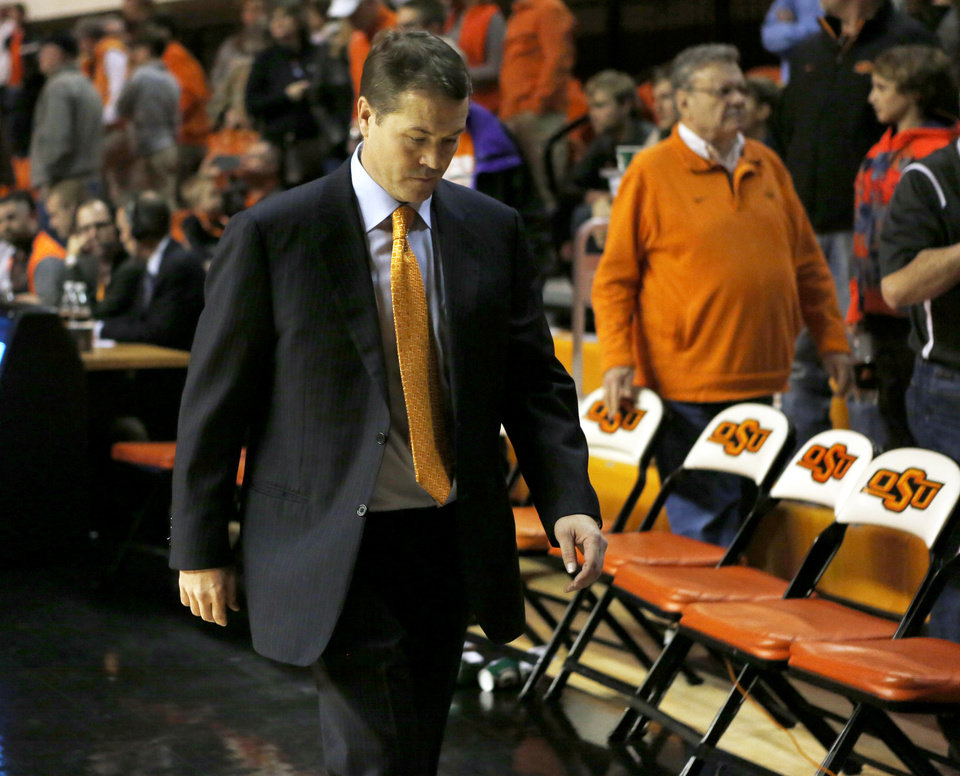 Photo - OSU coach Travis Ford leaves the court after a men's college basketball game between Oklahoma State and Missouri State at Gallagher-Iba Arena in Stillwater, Okla., Saturday, Dec. 5, 2015. Missouri State won 64-63. Photo by Nate Billings, The Oklahoman