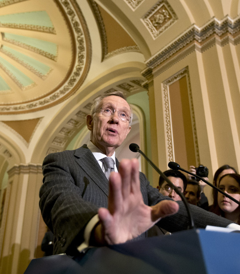 Senate Majority Leader Harry Reid, D-Nev., meets with reporters following a weekly Democratic strategy session, at the Capitol in Washington, Tuesday, Jan. 29, 2013.   (AP Photo/J. Scott Applewhite)